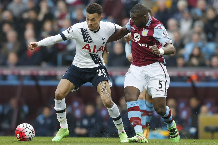 Dele Alli holds of Jores Okore during Tottenham's Premier League clash with Aston Villa