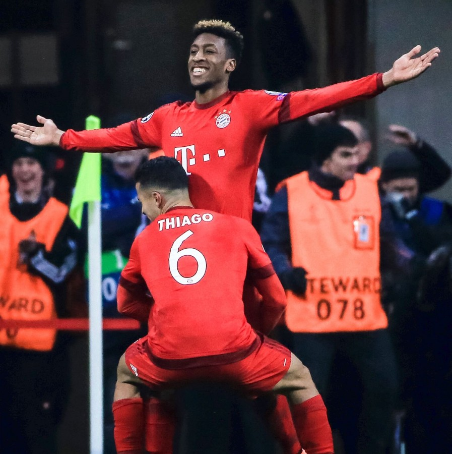 Kingsley Coman celebrates his  clincher against Juventus with Bayern team-mate, Thiago